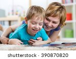 mother reading a book to her son | Shutterstock . vector #390870820