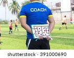 coach is coaching children... | Shutterstock . vector #391000690