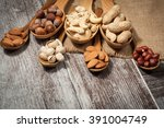 healthy mix nuts on wooden... | Shutterstock . vector #391004749