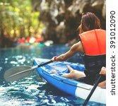 family kayaking and makes selfie | Shutterstock . vector #391012090
