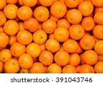 fresh mandarin oranges texture | Shutterstock . vector #391043746