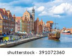 colourful historic houses near... | Shutterstock . vector #391072360