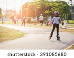 young couples roller skates... | Shutterstock . vector #391085680