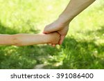 the parent holds the hand of a... | Shutterstock . vector #391086400