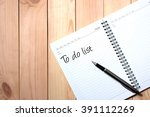 note book with black pen.... | Shutterstock . vector #391112269