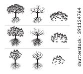 set of black trees and roots.... | Shutterstock .eps vector #391124764