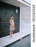 beautiful girl posing on a...   Shutterstock . vector #391161319