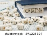 trade word background on wood... | Shutterstock . vector #391225924
