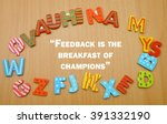 """Small photo of A word """"feedback is the breakfast of champions"""" in a circle of colorful alphabet letter with the wood background. copy space. Business, technology, internet concept. Stock Photo"""