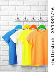 male clothes on hangers in a... | Shutterstock . vector #391384726