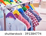 clothes for children on hangers ... | Shutterstock . vector #391384774