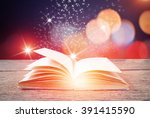 abstract magic book on wooden...   Shutterstock . vector #391415590