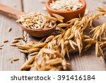 oat ears of grain on a wooden... | Shutterstock . vector #391416184
