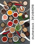 Small photo of Spice and herb food seasoning sampler over grey slate tile background.