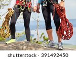 a couple of climbers with ropes ... | Shutterstock . vector #391492450