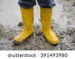human leg with yellow muddy... | Shutterstock . vector #391493980