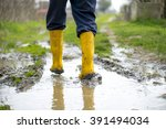 human leg with yellow muddy... | Shutterstock . vector #391494034
