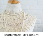 lace dress and pearl necklace... | Shutterstock . vector #391505374