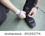 tying sports shoe | Shutterstock . vector #391552774