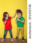 adorable boy and girl having... | Shutterstock . vector #391555738
