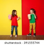 Adorable Boy And Girl Having...