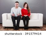 shy woman and man sitting on... | Shutterstock . vector #391579414