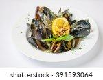 mussels in shells in a creamy... | Shutterstock . vector #391593064