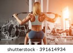 blonde sexy fitness woman in... | Shutterstock . vector #391614934