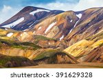 Valley National Park Landmannalaugar. On the gentle slopes of the mountains are snow fields and glaciers. Magnificent Iceland in the July