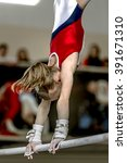 girl gymnast during exercise on ... | Shutterstock . vector #391671310