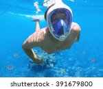 Snorkeler And Coral Reef ...