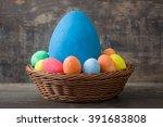 Basket Of Easter Eggs On Rusti...