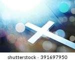 cross on wood and bokeh... | Shutterstock . vector #391697950