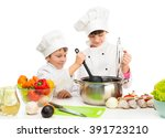 little chefs by table with...