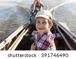 Happy Boy Riding In A Boat Wit...