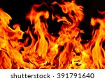 spurts of flame on black... | Shutterstock . vector #391791640
