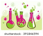 three colored flasks with...