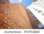 a high red brick house with... | Shutterstock . vector #391916860