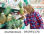 Woman Sniffing A Pineapple In...