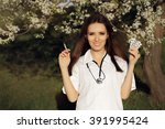 Small photo of Spring Female Doctor with Vaccine Syringe and Pills - Allergist holding immunization vaccine and antihistaminic pills