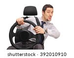 Confident Young Man Driving An...
