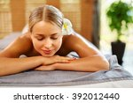 spa woman. beauty treatment.... | Shutterstock . vector #392012440