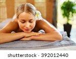 spa woman. beauty treatment.... | Shutterstock . vector #392012440