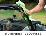 hand cleaning the car.   Shutterstock . vector #392044663