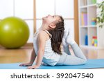 child girl doing gymnastics | Shutterstock . vector #392047540