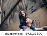 walking a young dad and his... | Shutterstock . vector #392131900
