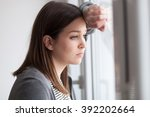 sad looking young woman... | Shutterstock . vector #392202664
