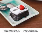small piece of chocolate cake... | Shutterstock . vector #392203186