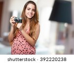 young woman holding a vintage... | Shutterstock . vector #392220238