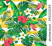 tropical flowers and leaves on... | Shutterstock .eps vector #392223259